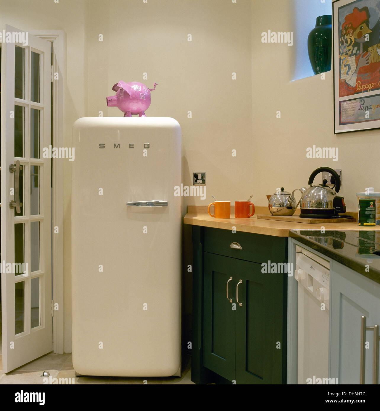 pink plastic pink on smeg fridge in corner of modern. Black Bedroom Furniture Sets. Home Design Ideas