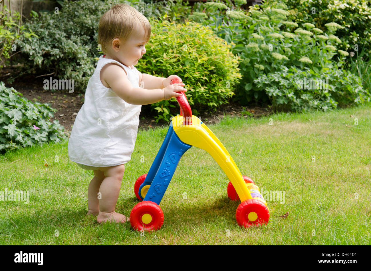 Toys For Toddlers Learning To Walk : Nine month old girl learning to walk with baby walker toy