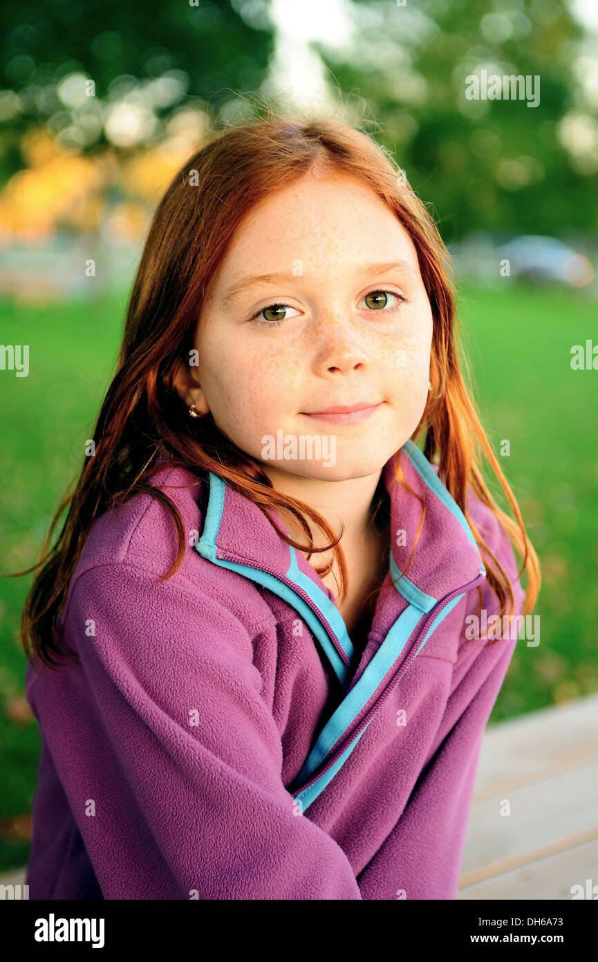 Portrait Of A Beautiful Eight Year Old Redhead Girl With