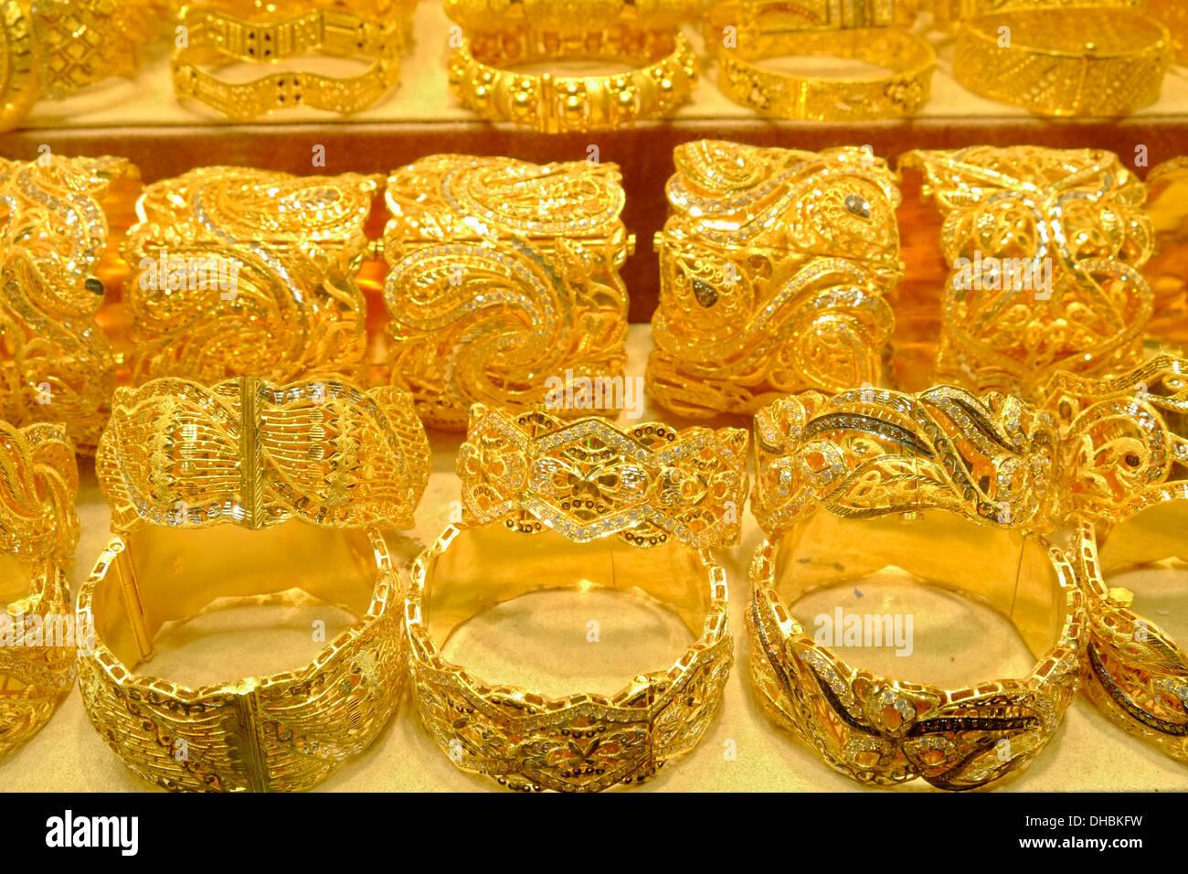 Gold bracelets jewelery for sale in shop in Gold Souk in