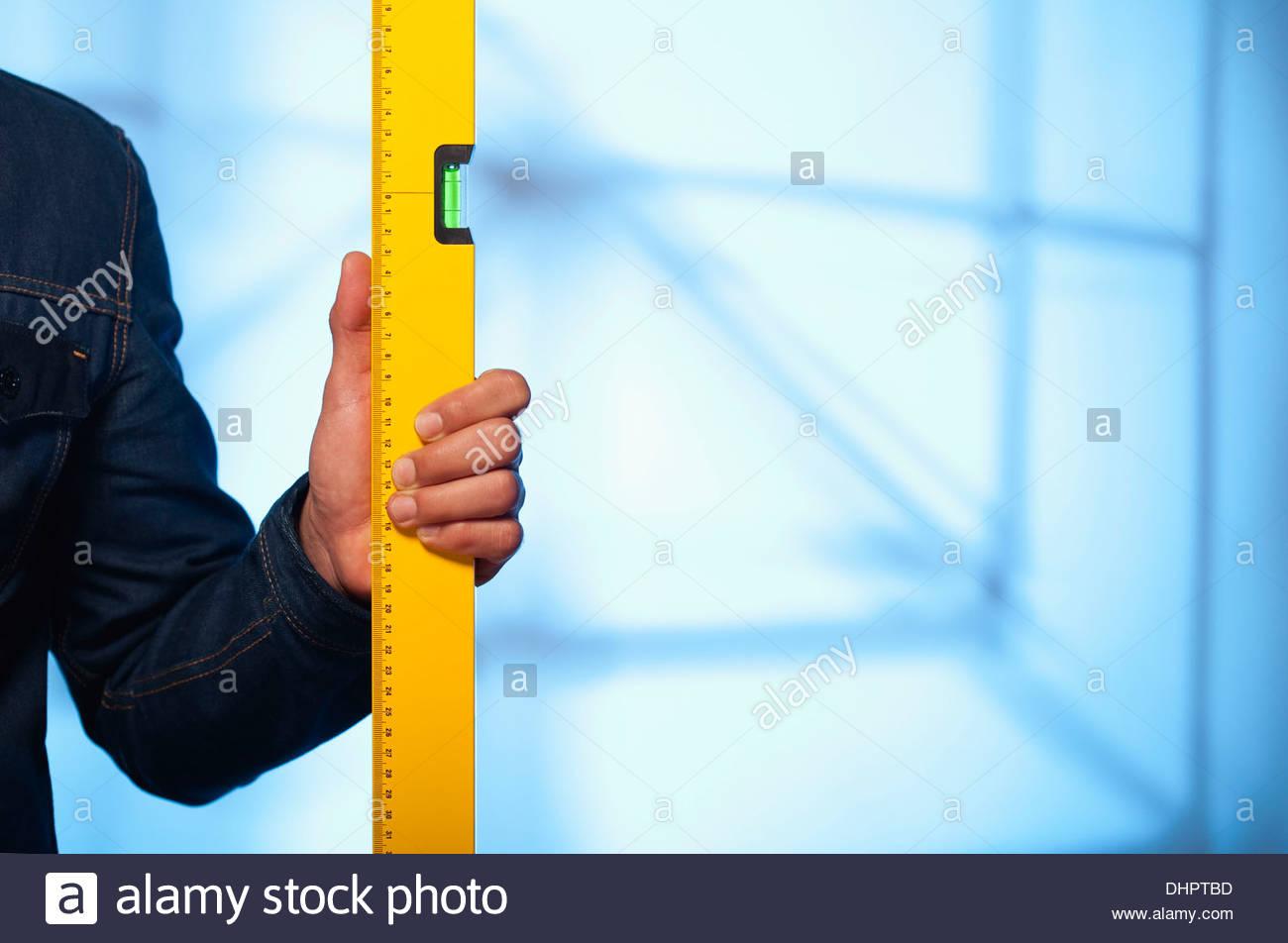 spirit level man hand construction holding builder Stock Photo