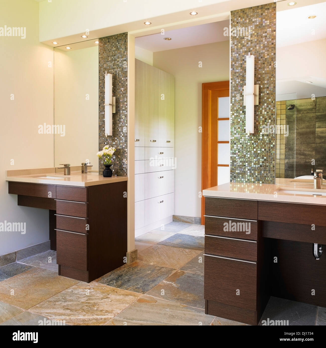 Master Bathroom With 2 Vanities Leading Into Walk In Closet Stock Photo Royalty Free Image