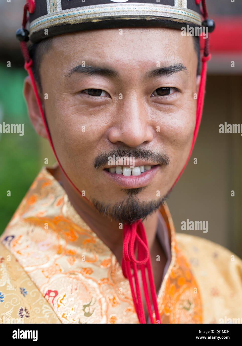 Okinawan Man In Traditional Costume At Ryukyu Mura
