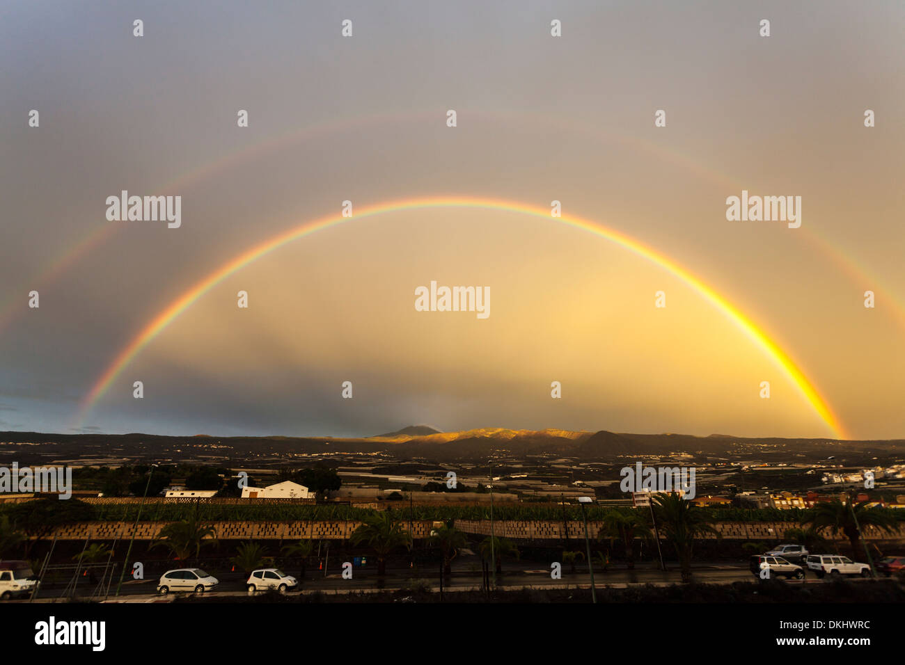 a-double-rainbow-arches-over-the-mountai