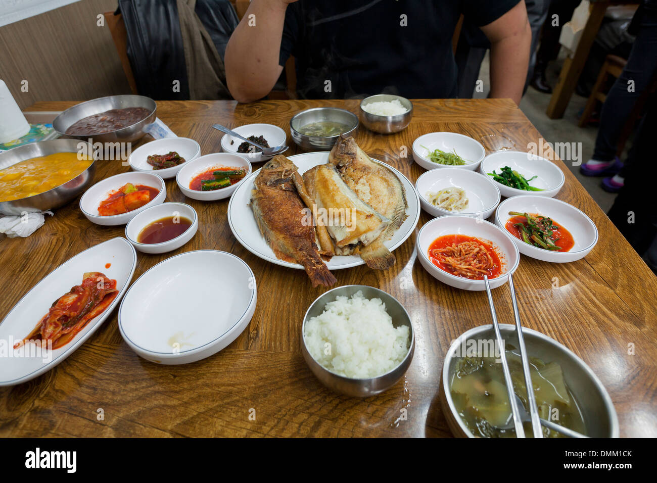 Korean fried fish meal and side dishes on table south for Side dishes for fried fish