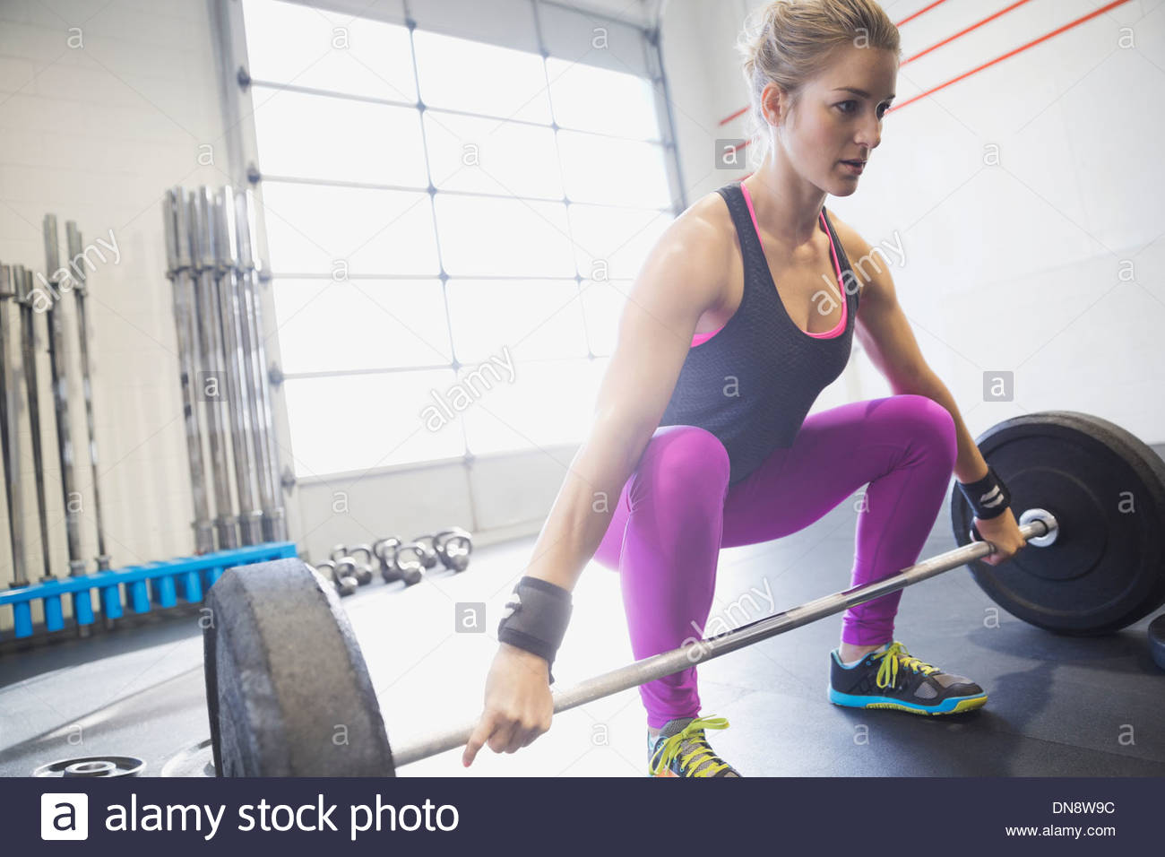 Woman practicing deadlifts Stock Foto