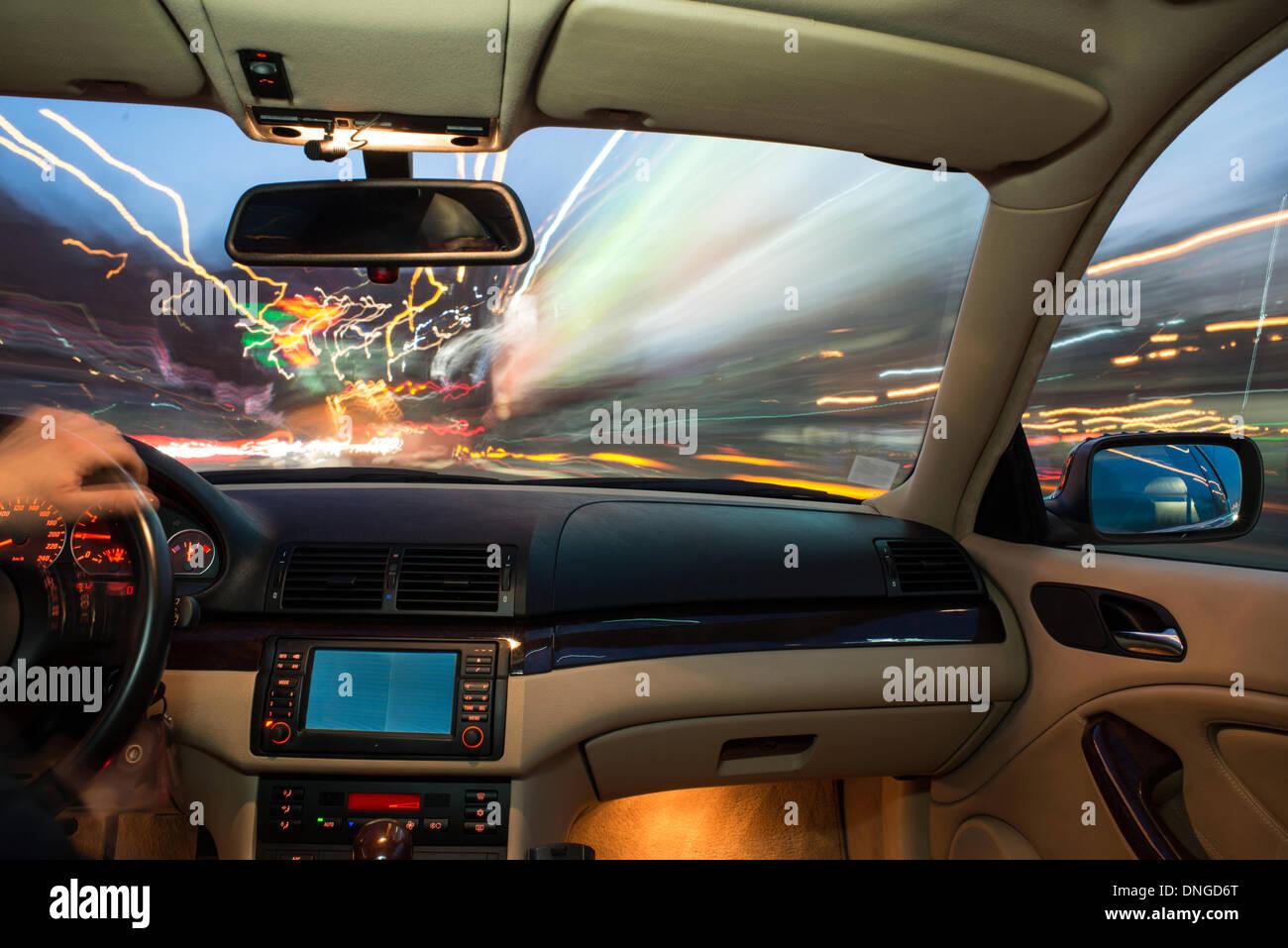 car interior on driving blurred night lights stock photo 64900496 alamy. Black Bedroom Furniture Sets. Home Design Ideas