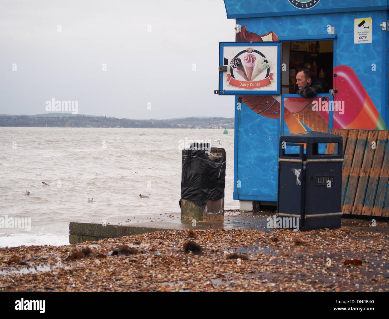 portsmouth-england-4th-january-2014-an-ice-cream-vendor-peers-out-DNRB4G.jpg