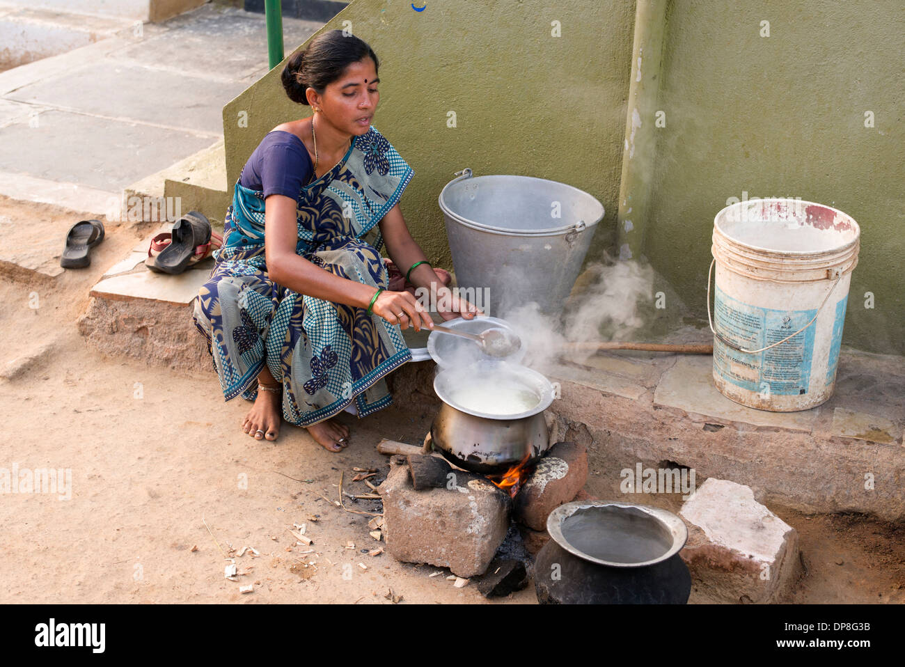 http://c7.alamy.com/comp/DP8G3B/indian-woman-cooking-rice-on-an-open-fire-outside-her-home-in-a-rural-DP8G3B.jpg Indian Woman Cooking