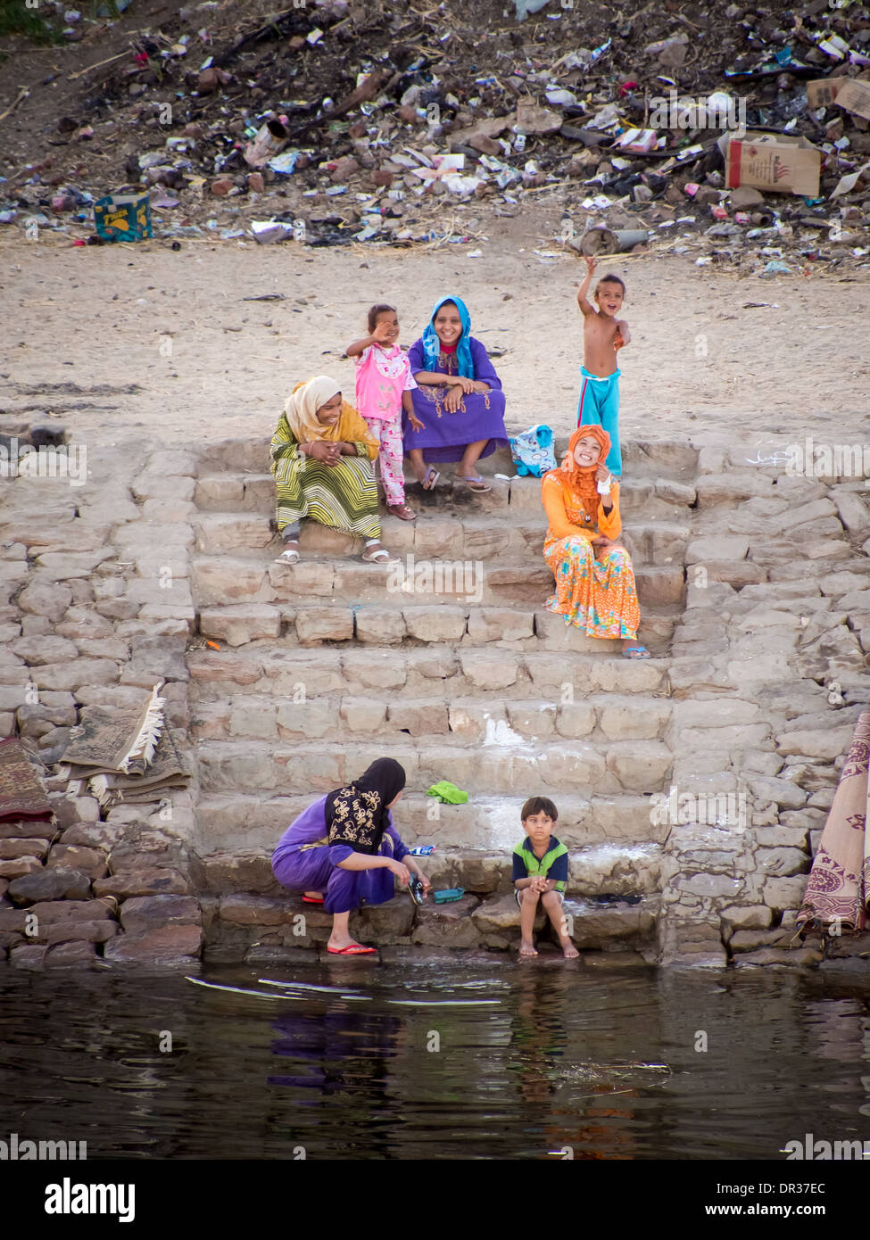 women-and-children-sitting-on-steps-on-t