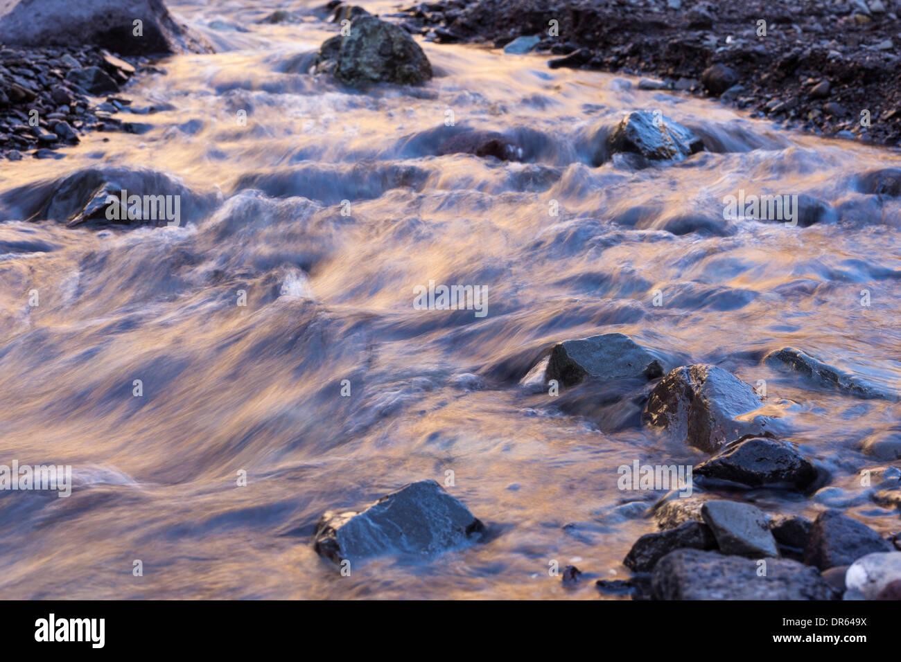stream-of-water-flowing-over-stones-in-t