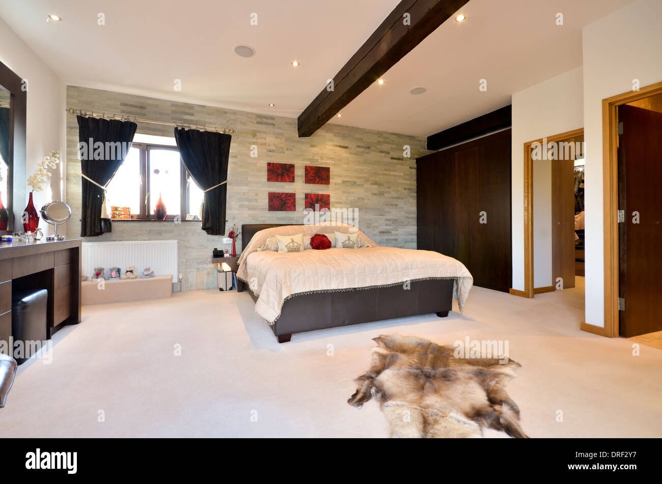 Stylish master bedroom with ensuite and dressing room stock photo royalty free image 66099803 Master bedroom ensuite and wardrobe