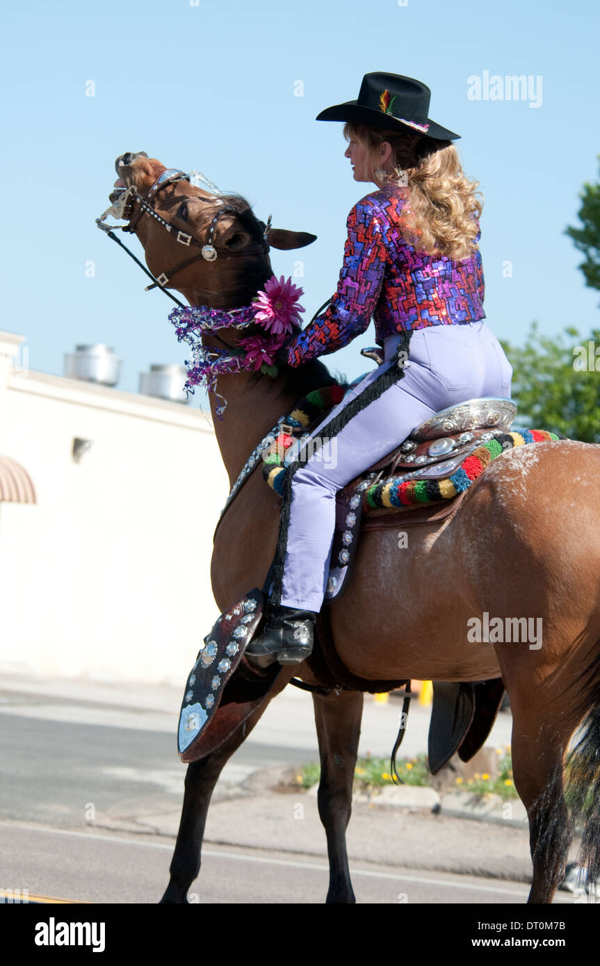 cowgirl-on-a-horse-with-decorated-saddle