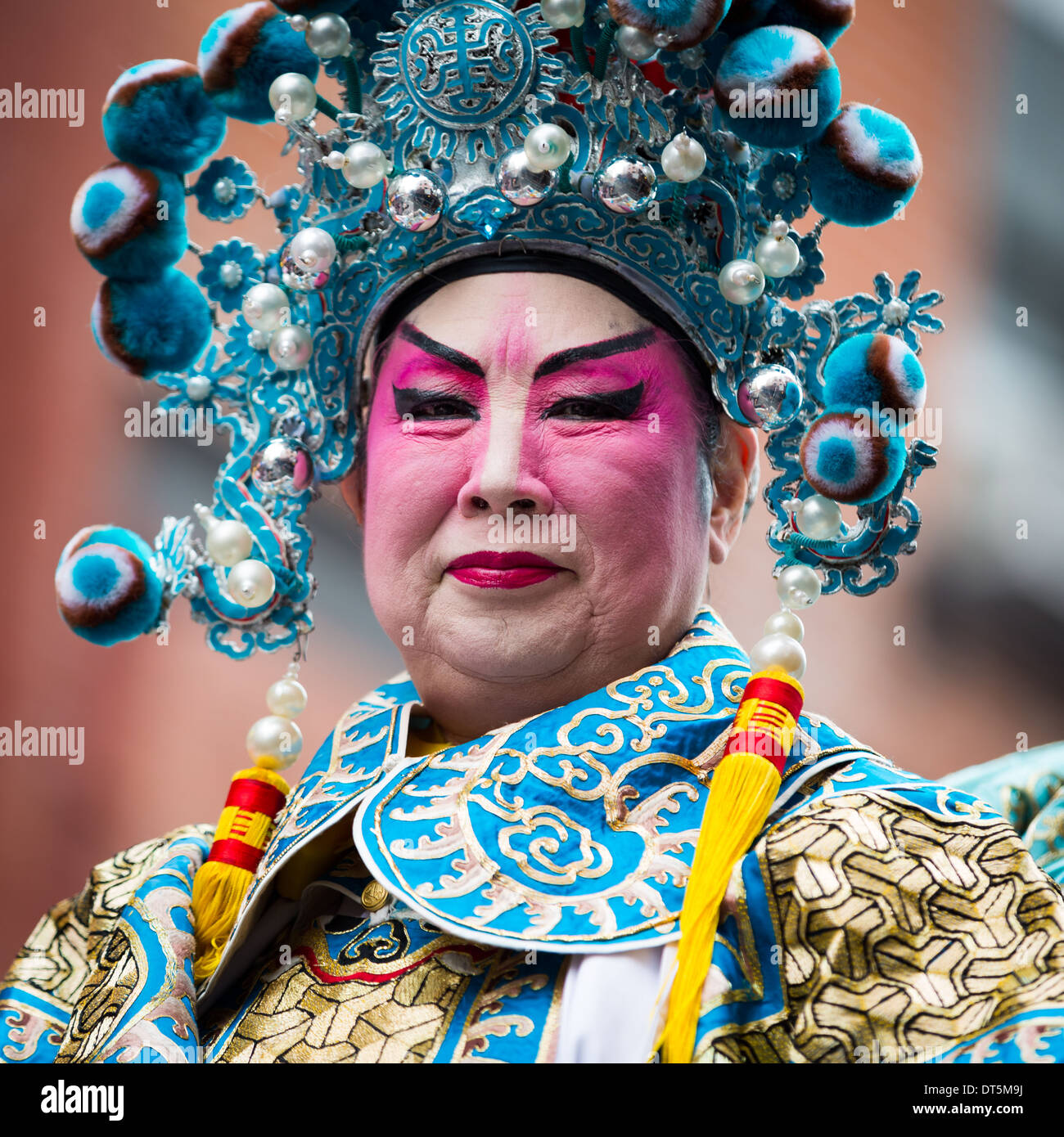 Proud Chinese man wearing makeup parades at the Lunar New Year Festival in Chinatown. Stock Foto