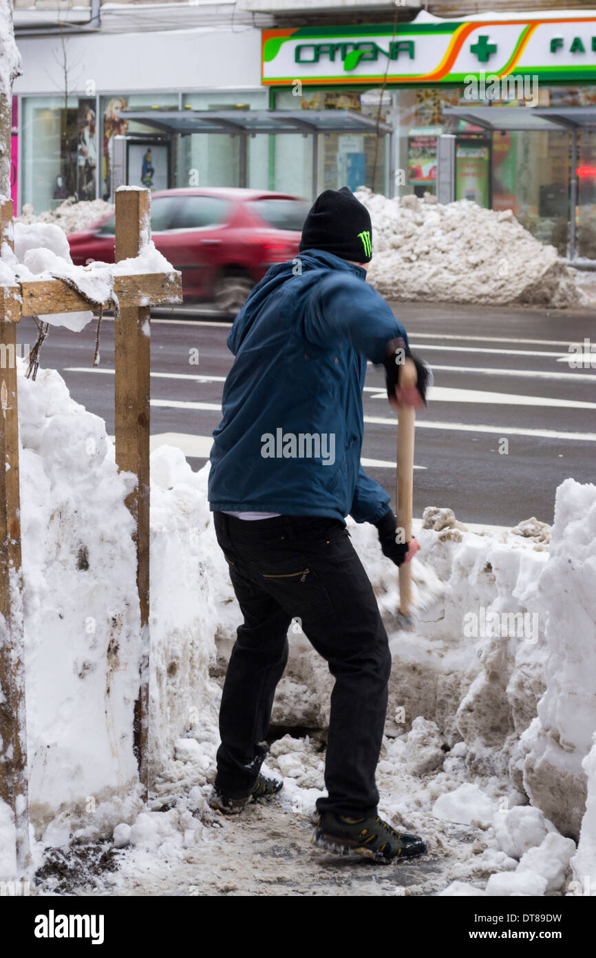 man-shoveling-snow-in-bucharest-romania-