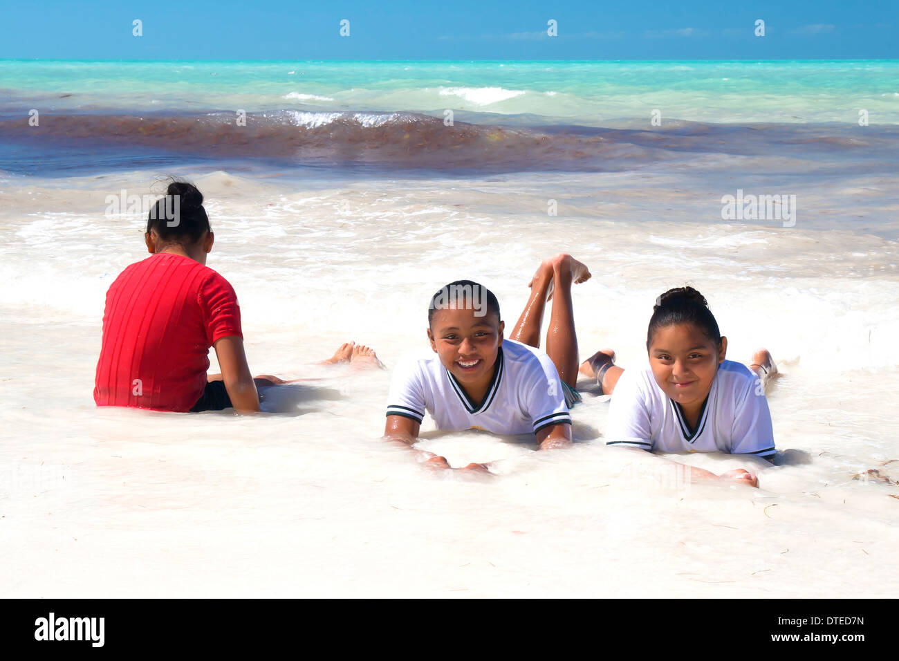 mexican-girls-in-their-school-uniforms-enjoying-the-warm-waters-of-DTED7N.jpg