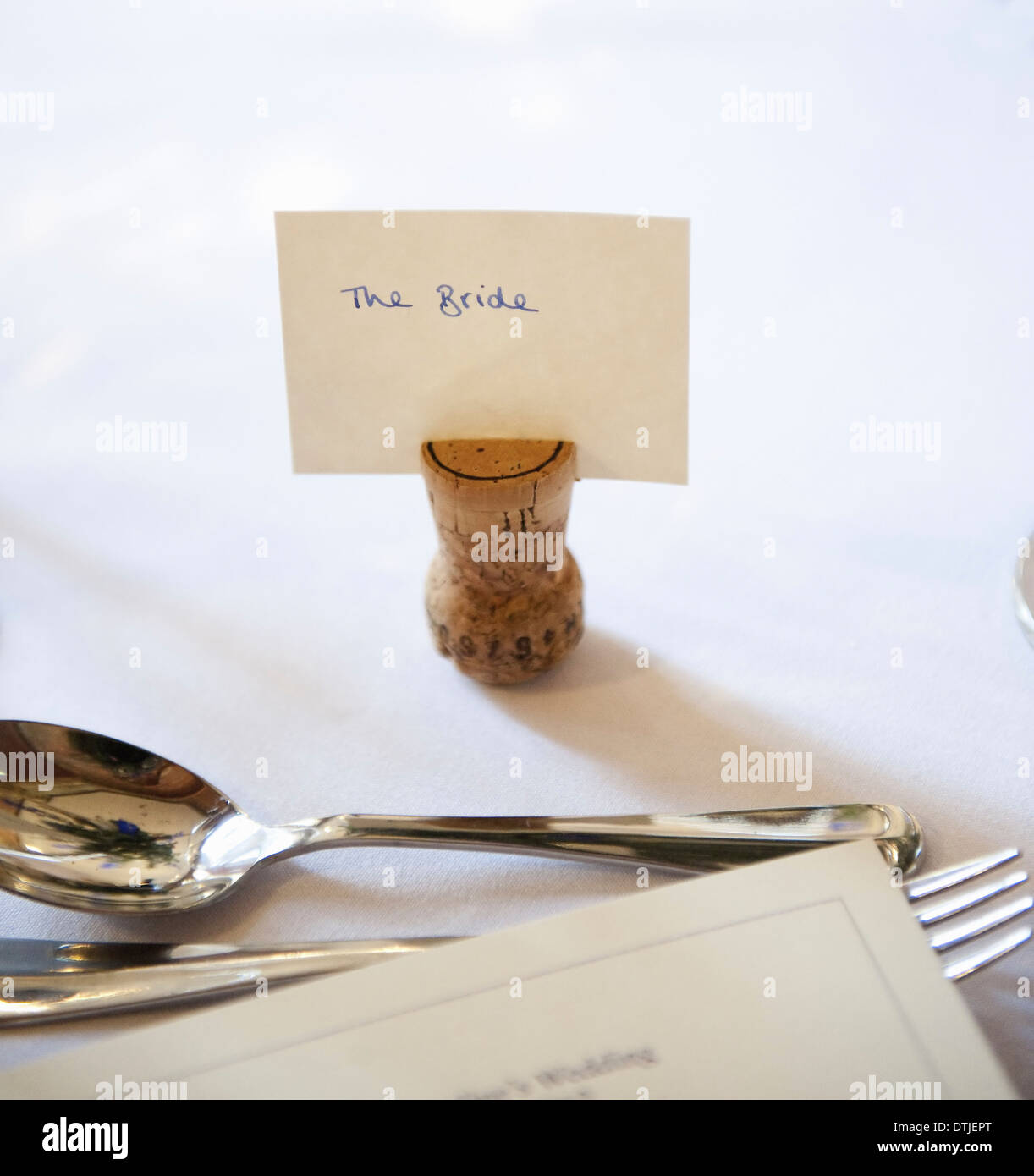 Top table at a wedding banquet an upside down cork with a for Tag table html