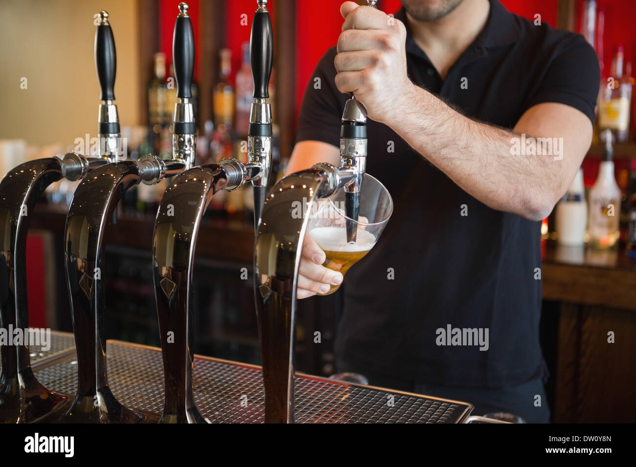 Barkeeper pulling a pint of beer Stock Photo