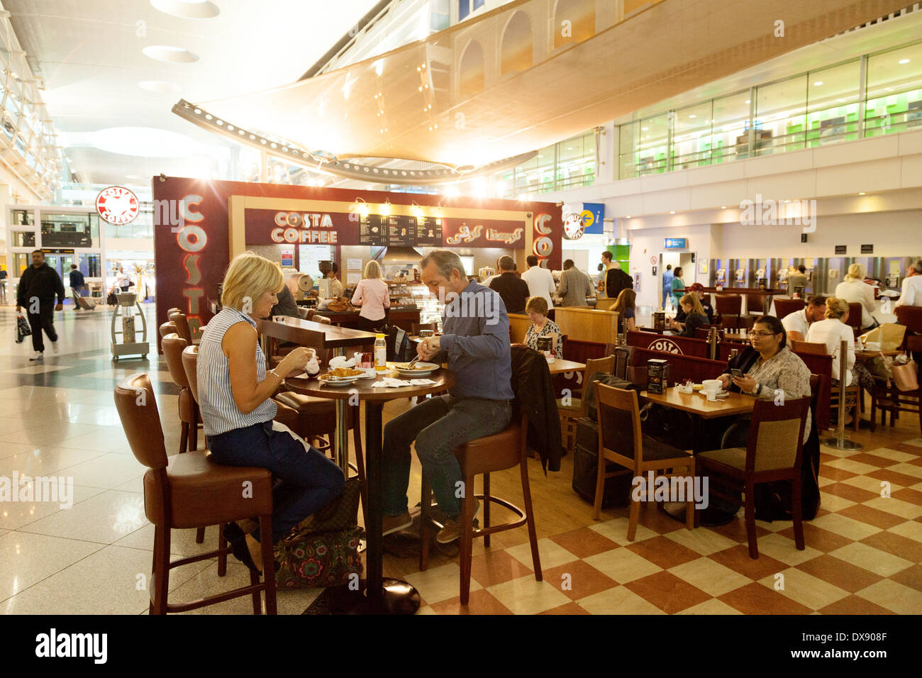 People drinking coffee at costa coffee dubai airport for Boutique one dubai