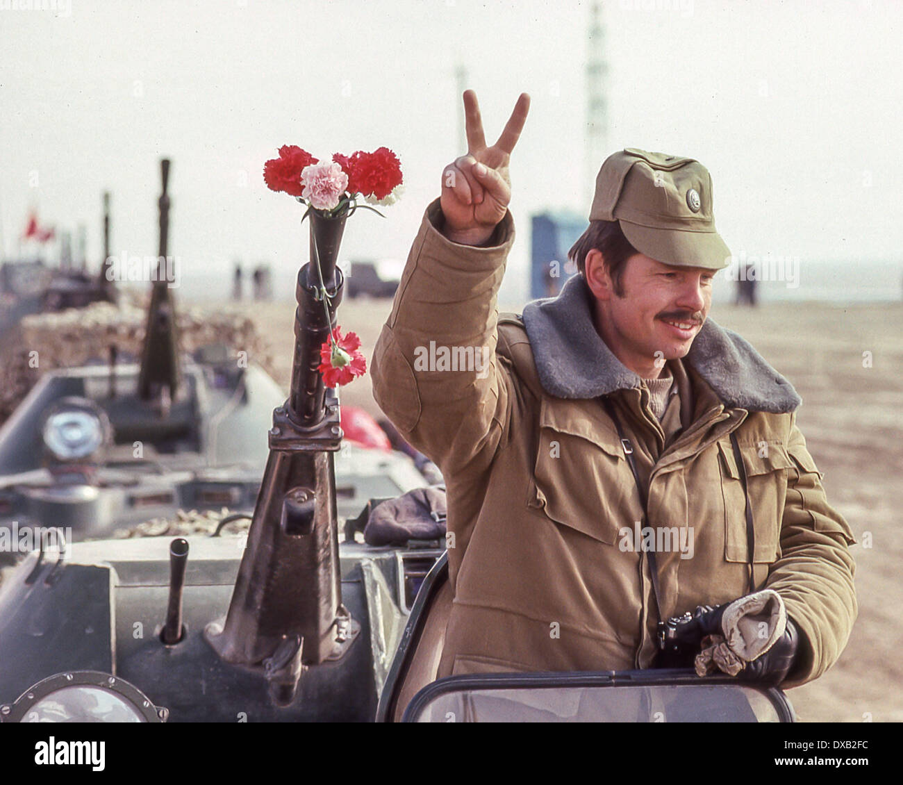 Soviet Afghanistan war - Page 6 Feb-16-1989-termez-uzbekistan-ru-standing-atop-a-soviet-armored-personnel-DXB2FC