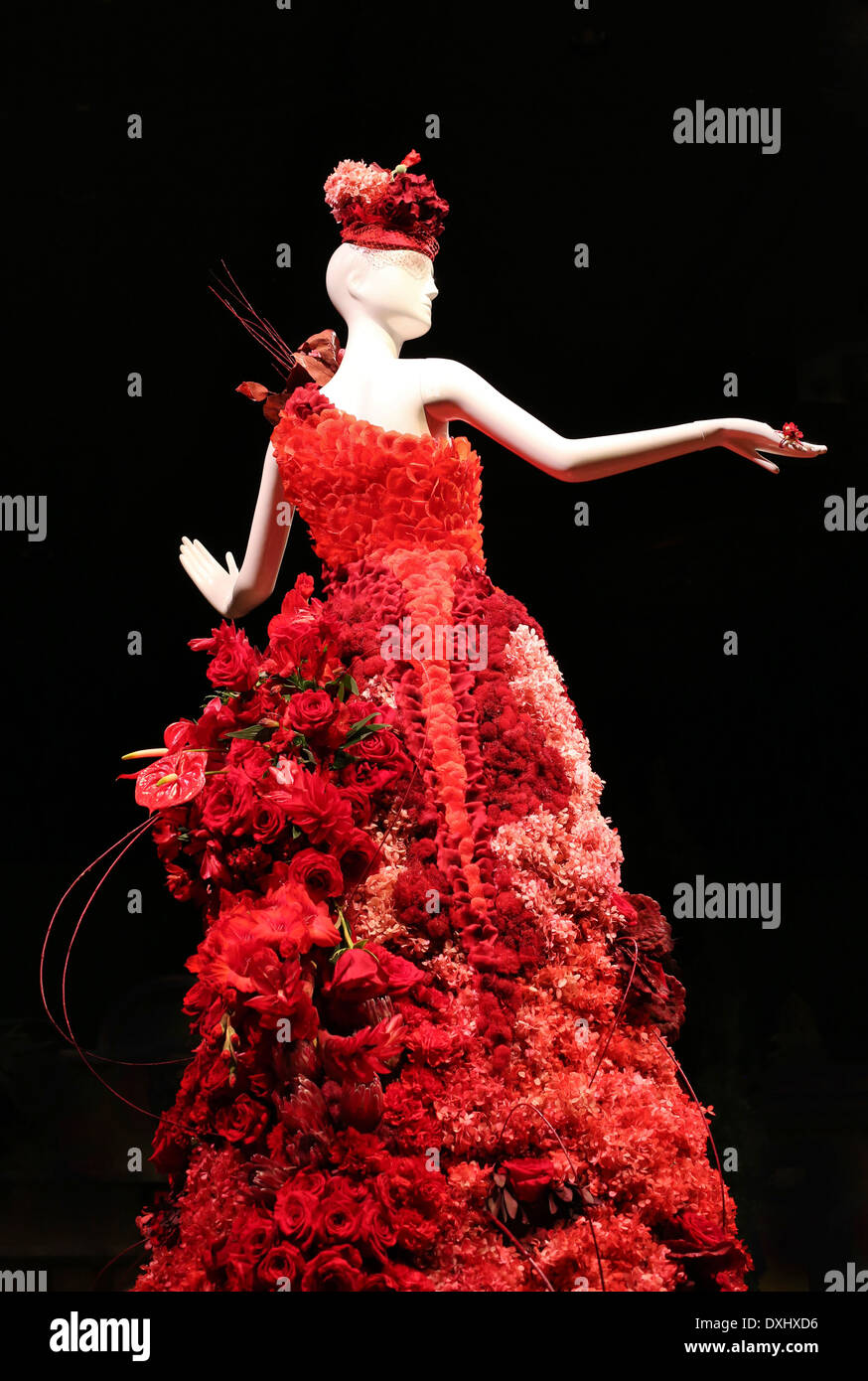 a-mannequin-in-a-dress-made-of-red-flowe
