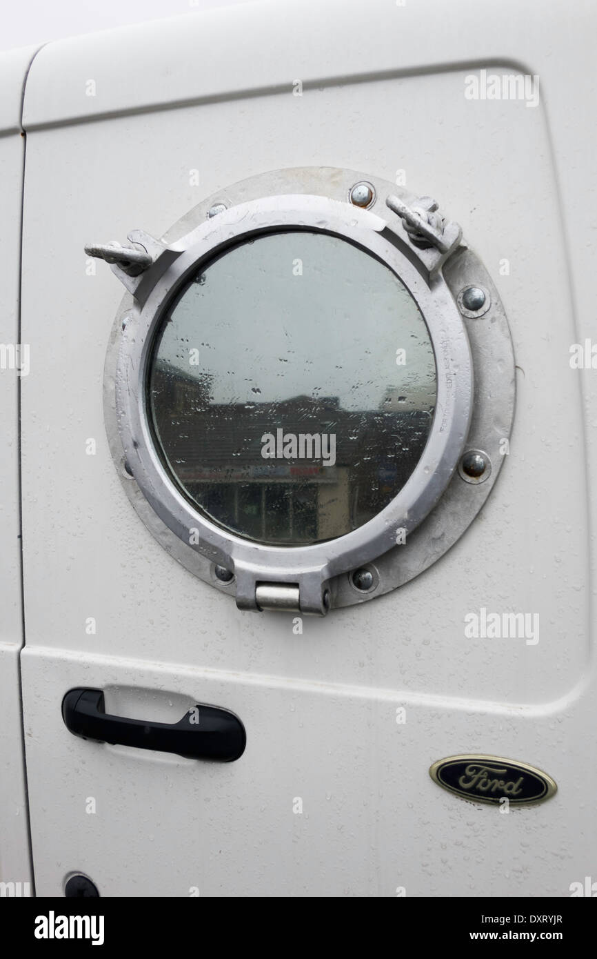 Unusual modification to a small white van rear doors for Back doors fitted