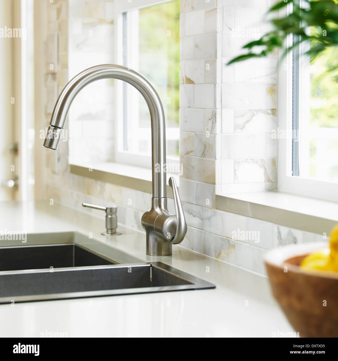 Kitchen Faucets Vancouver Bc: Close-up Of Stainless Steel Kitchen Faucet With Marble
