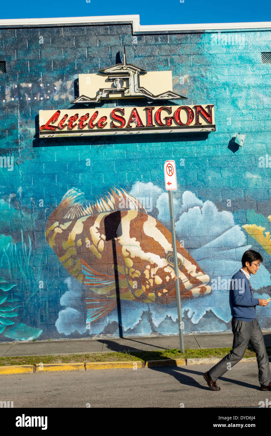 Stock Photo - Orlando Florida East Colonial Drive Little Saigon sign mural Asian man street building