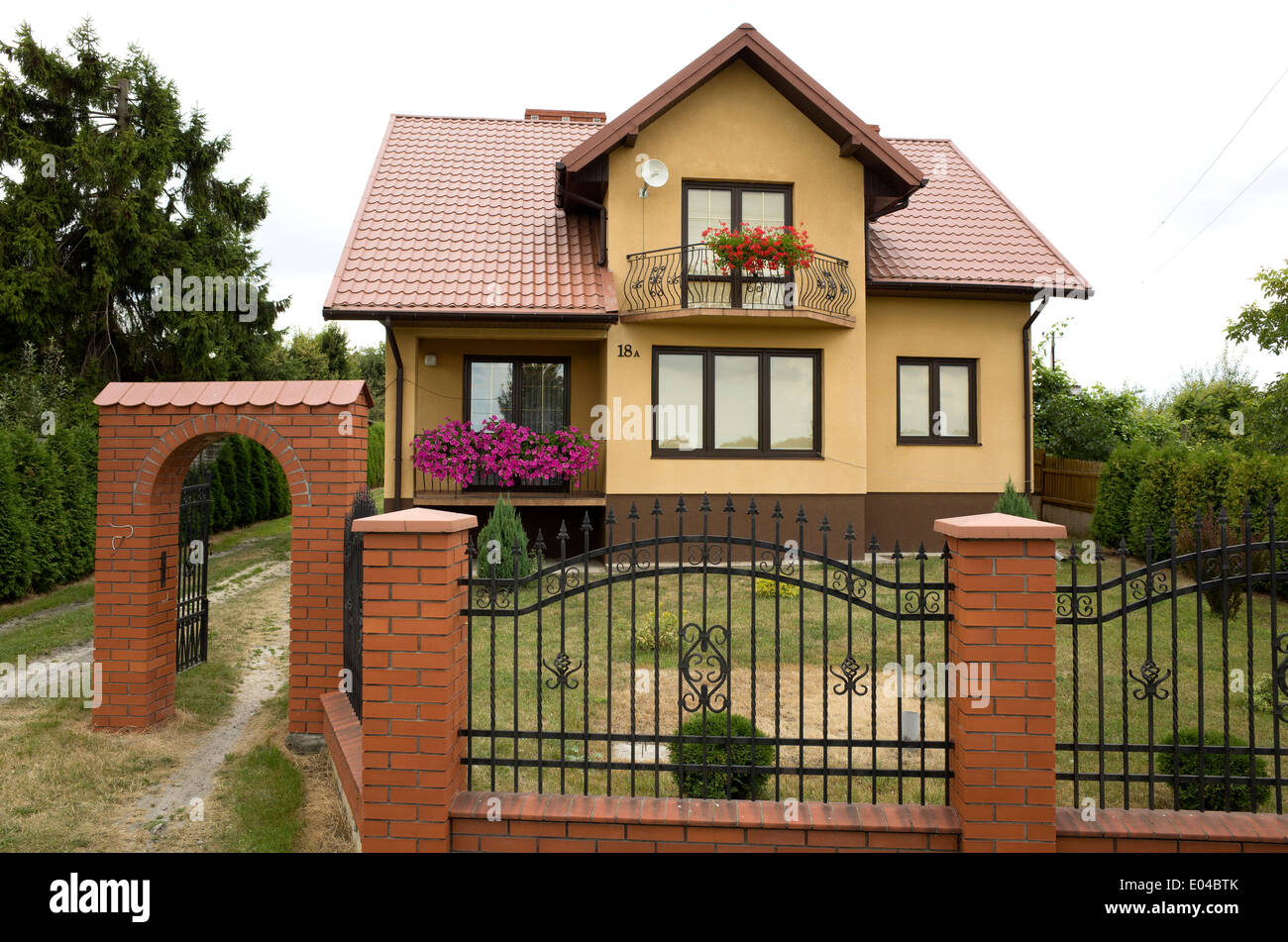 Modern Polish House With Wrought Iron Fence With Brick Pillars And Stock Photo Royalty Free
