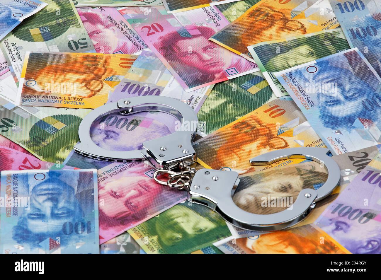 swiss francs money of switzerland with handcuffs schweizer franken stock photo royalty free. Black Bedroom Furniture Sets. Home Design Ideas