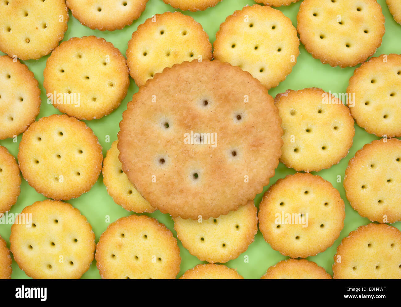 A group of small snack crackers on a green plate with a larger Stock Photo, Royalty Free Image: 69218507