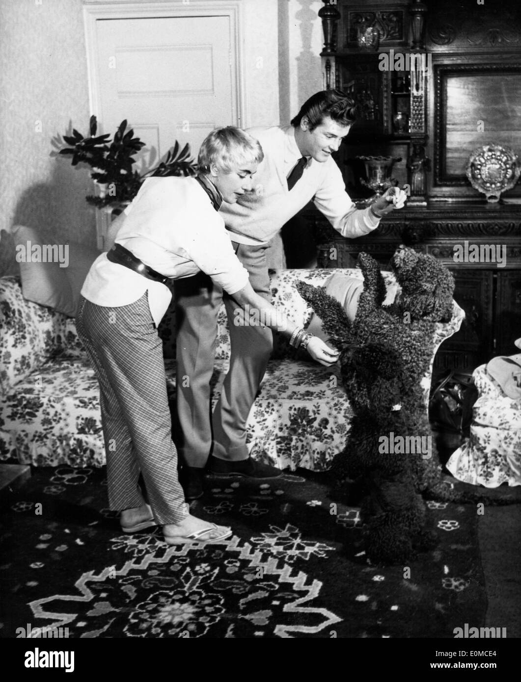Actor Roger Moore And Wife Dorothy Squires Playing With