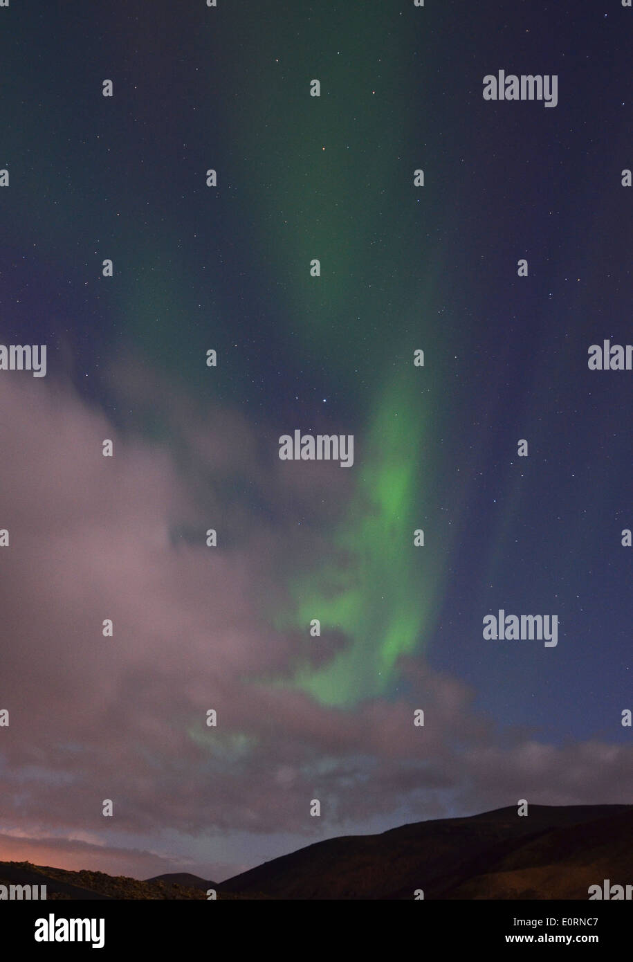 Clouds and Aurora Borealis above the Northern Lights Inn, near Grindavik, iceland Stock Photo