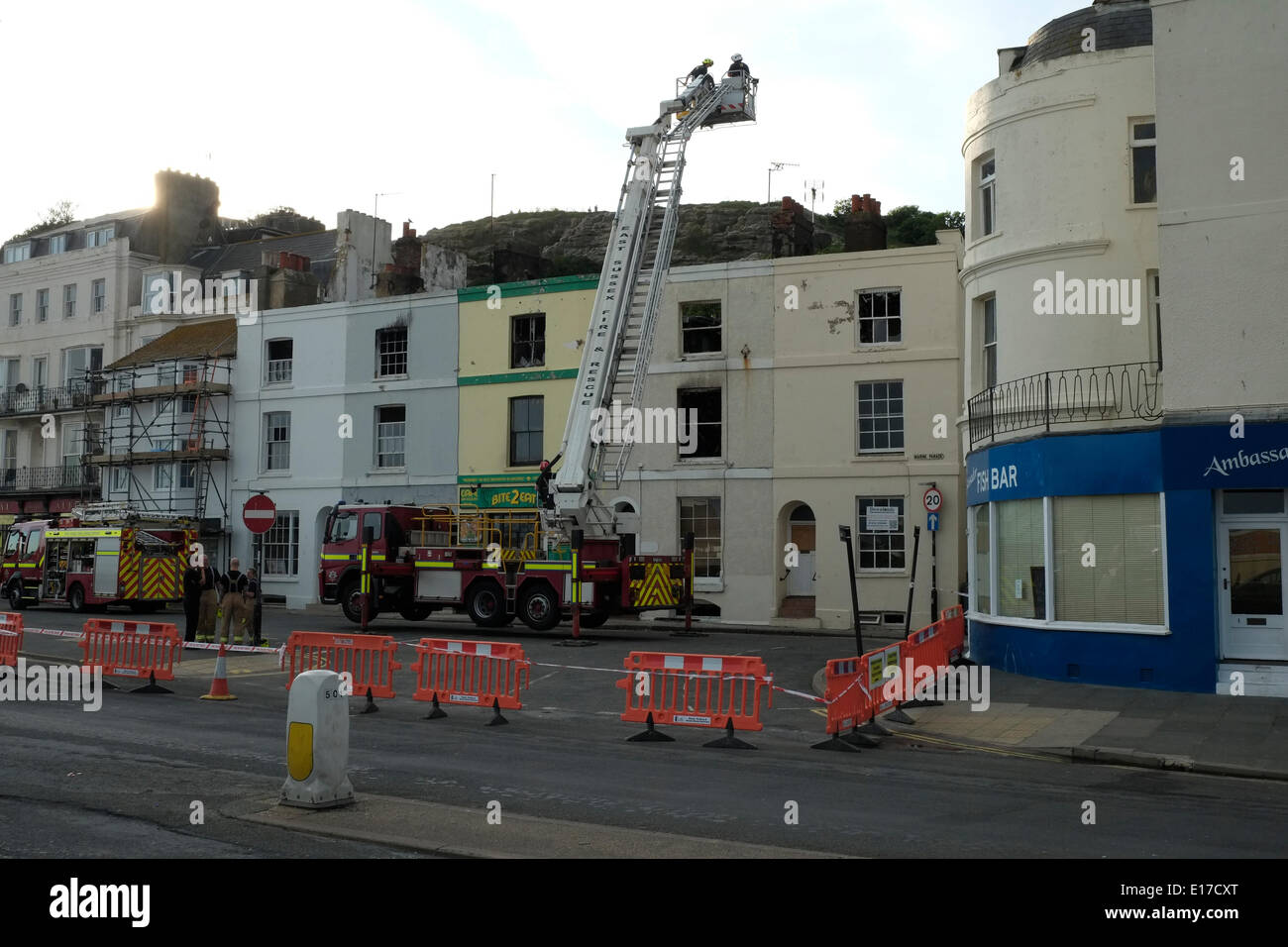 Hastings marine parade fire fighters examine burnt out for 17 marine terrace