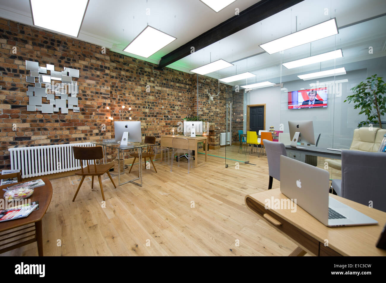 A modern clean light airy open plan estate agent 39 s office for Interior design agency uk