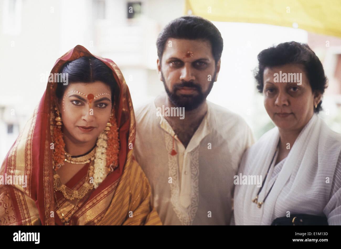 Portrait Of Indian Film Actress Kimi Katkar With Husband