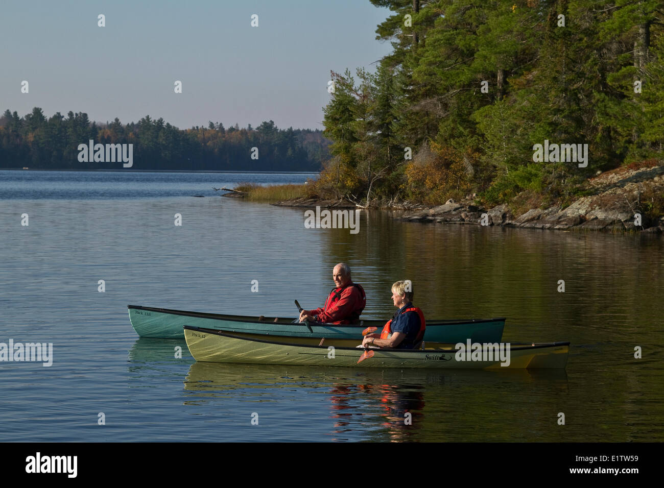 Retired Couple Kayaking On Source Lake Algonquin Park