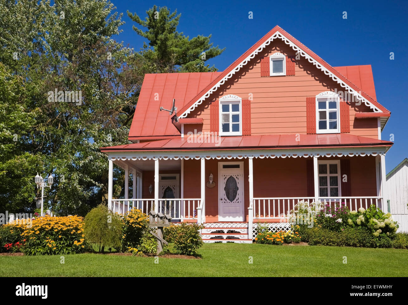 Salmon and white trim cottage style residential home for Residential house styles