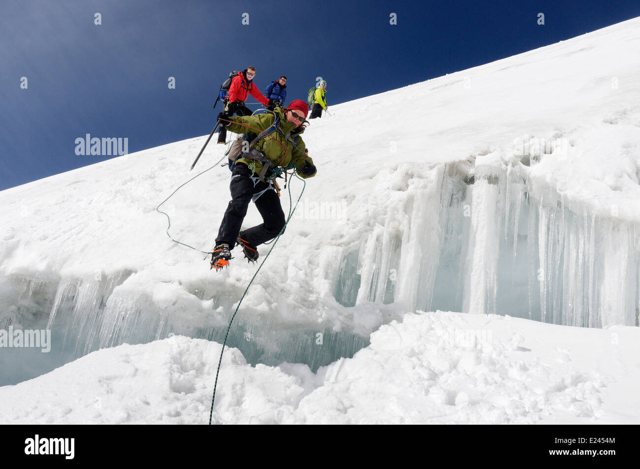 a-lady-climber-jumping-a-crevasse-in-the