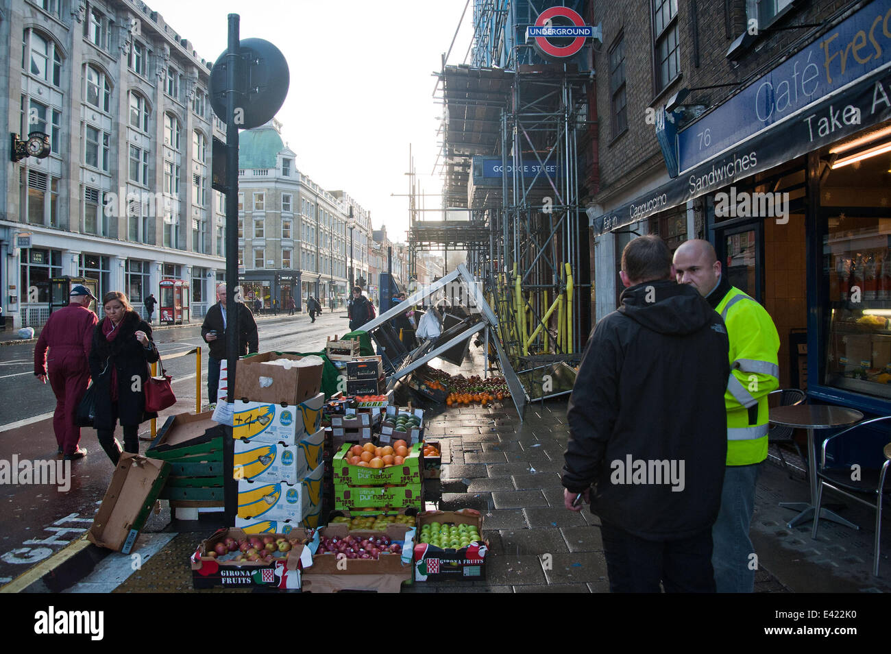 Fruit and vegetable stall blown over outside Goodge Street Station on Tottenham Court Road  Where: London, UK, United Stock Photo