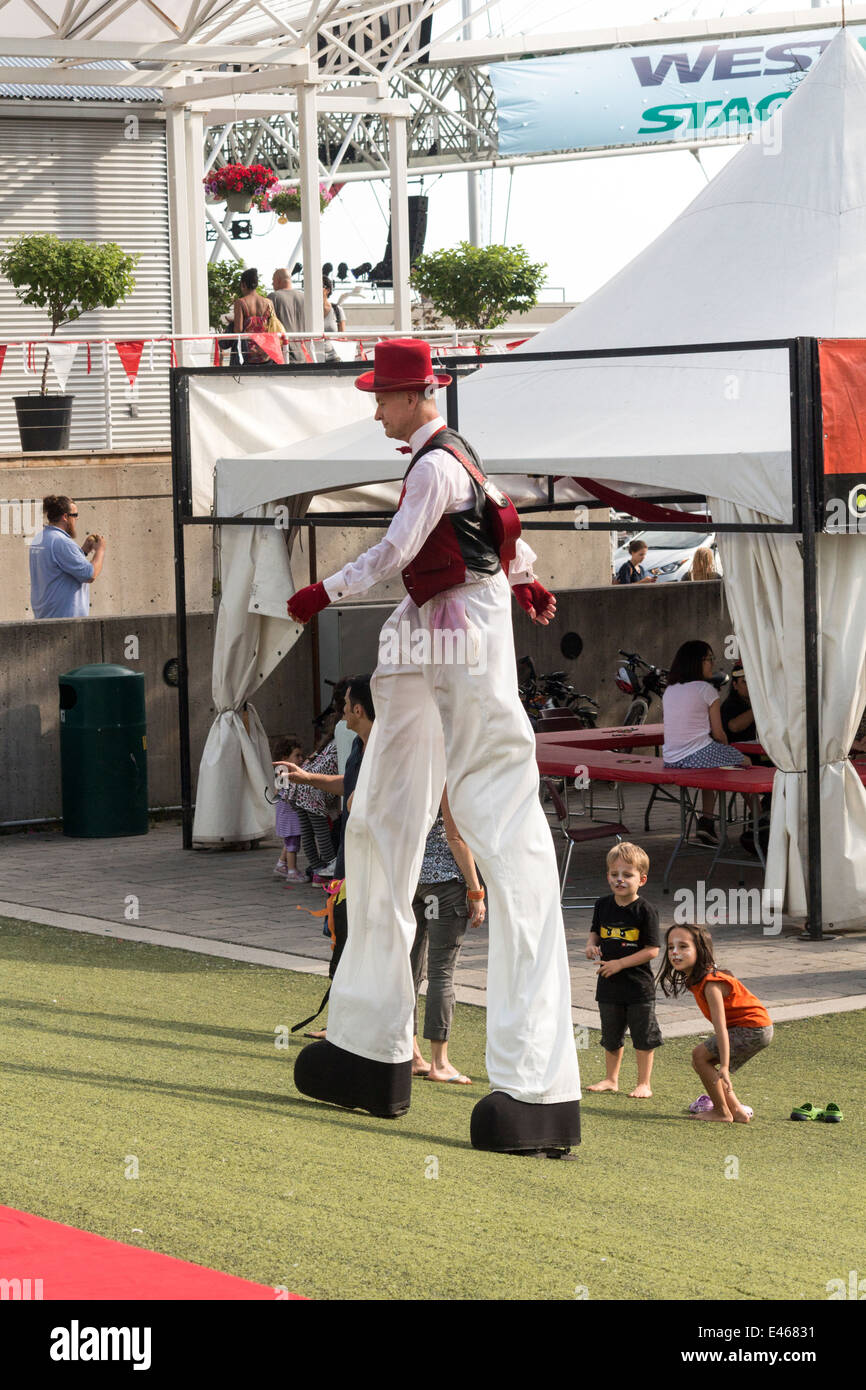 man-on-stilts-dressed-in-red-and-white-c