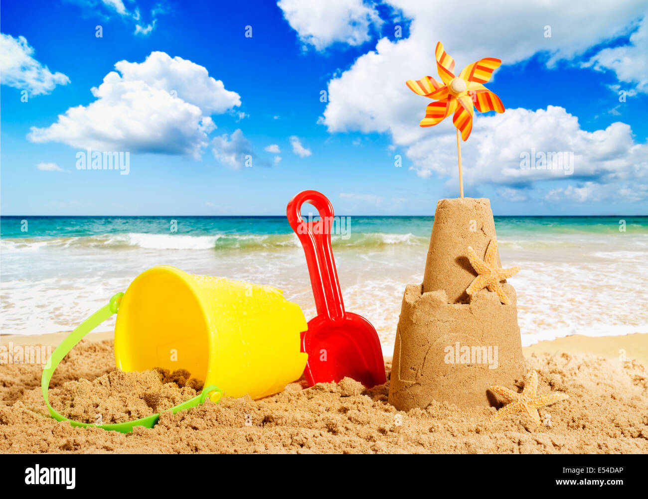 Sandcastles At The Beach With Bucket And Spade Stock Photo