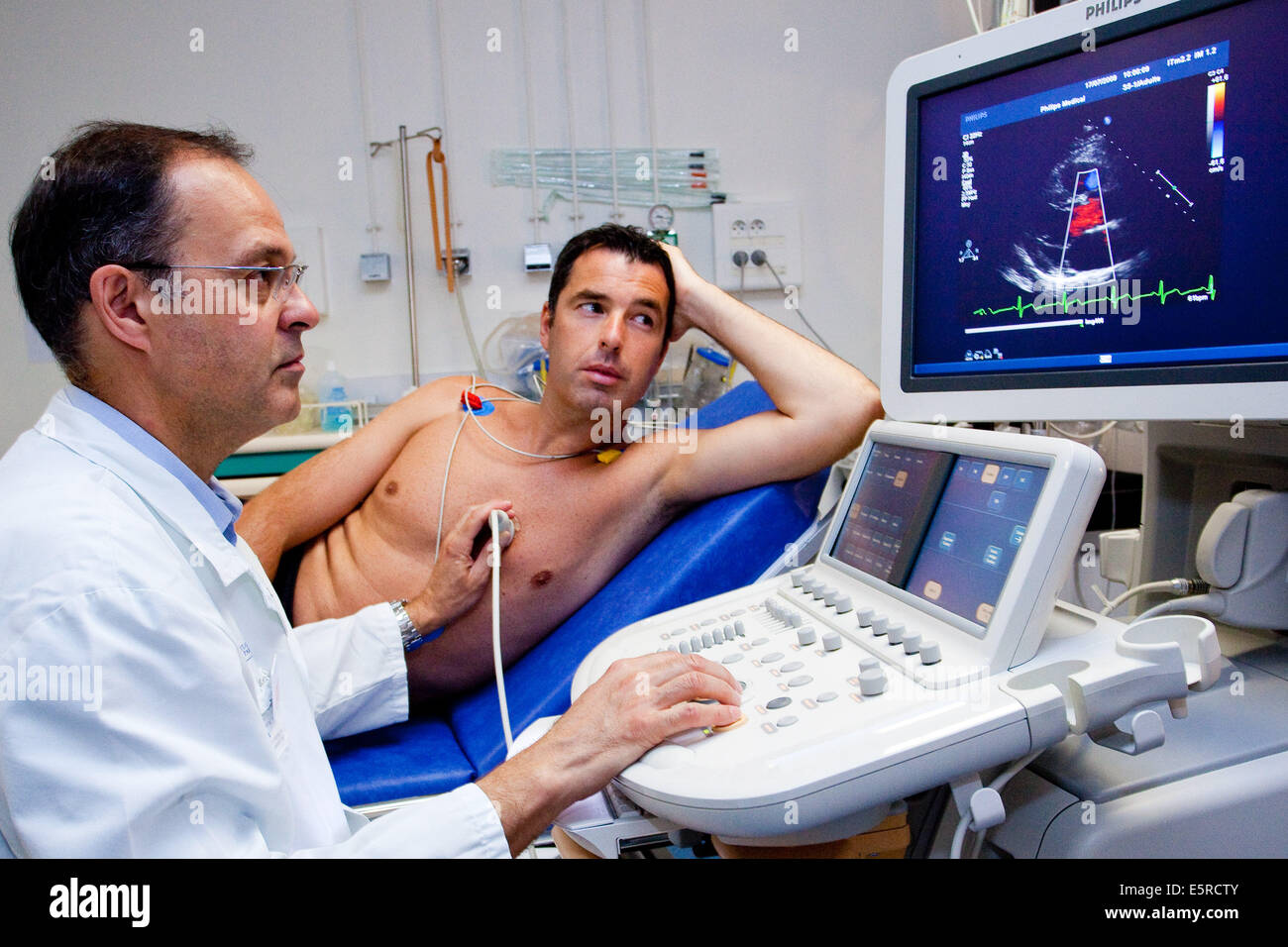 Man undergoing a heart scan doppler, Department of cardiology, Pitie-Salpetriere hospital, Paris, France. Stock Photo