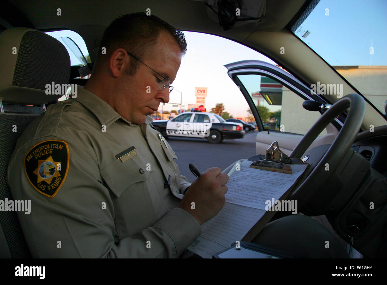 las vegas metropolitan police officer making a report in his police stock photo royalty free. Black Bedroom Furniture Sets. Home Design Ideas
