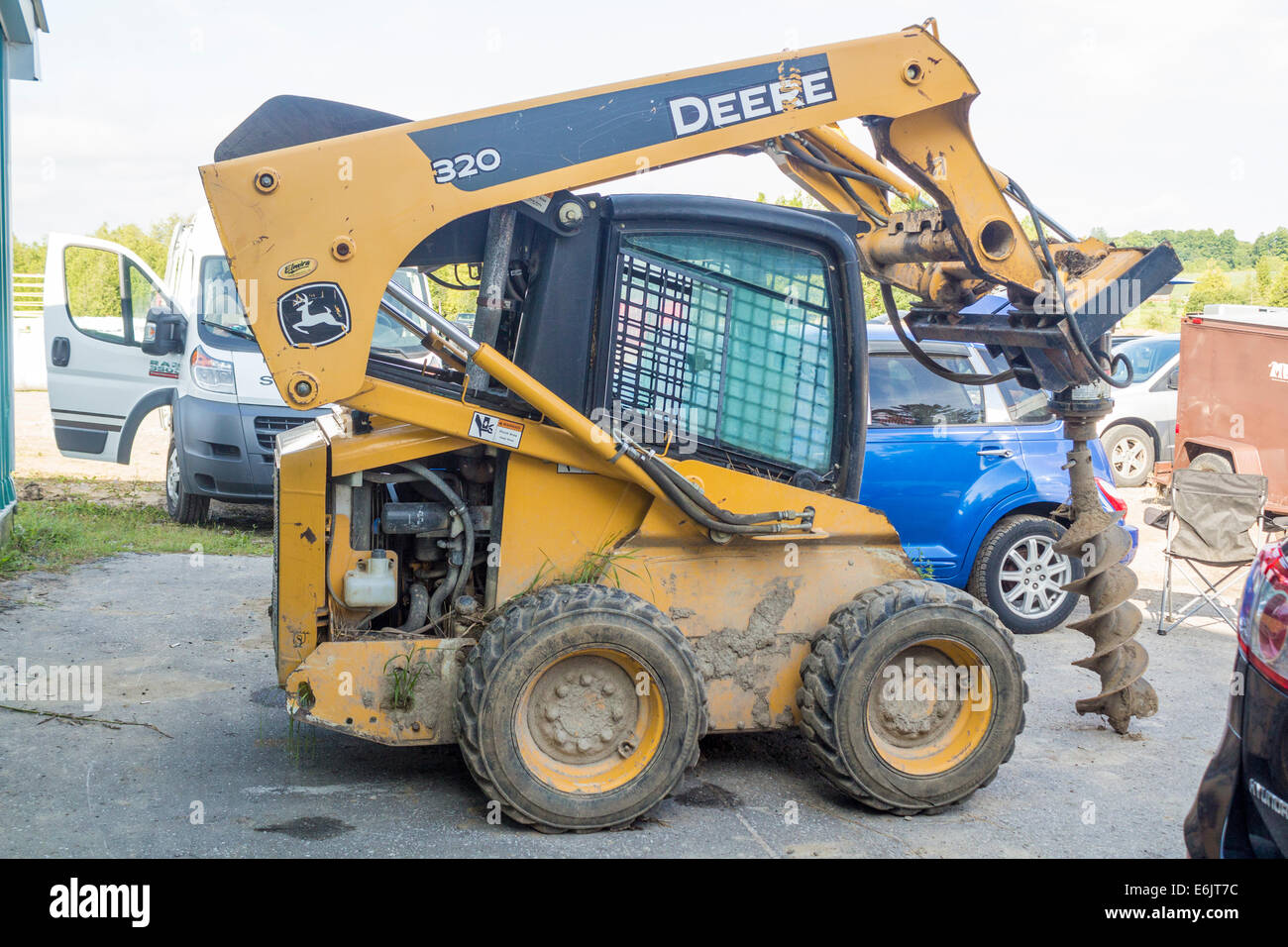johm-deere-skid-steer-with-attached-auge