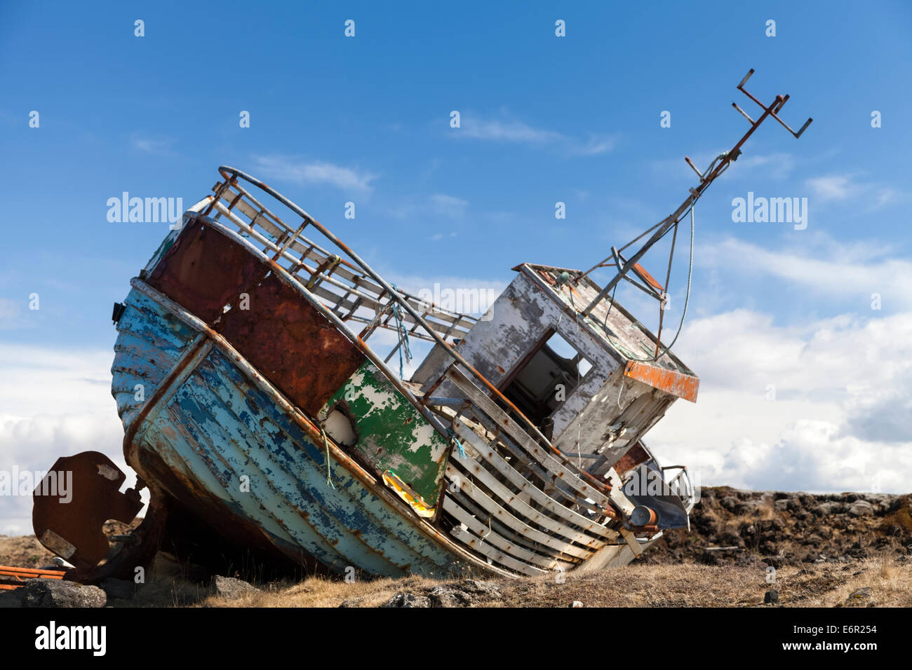 beached-and-deserted-old-fishing-boat-on