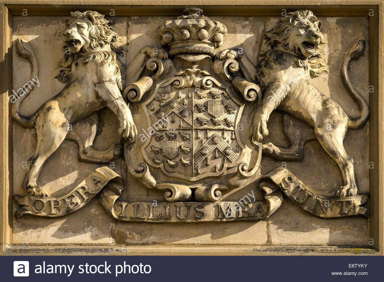 Brownlow family coat of arms and motto carved in stone