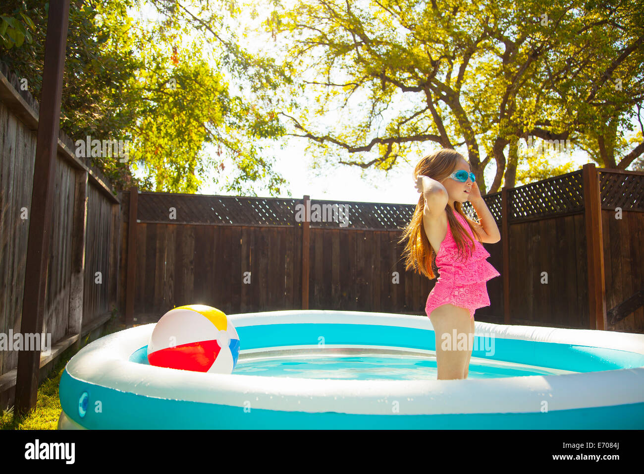 Girl in swimming goggles in garden paddling pool stock for Garden paddling pools