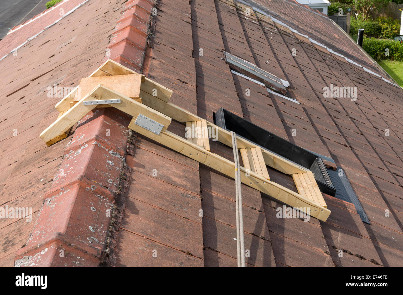 A Home Made Roof Step Ladder By A Skylight Window With