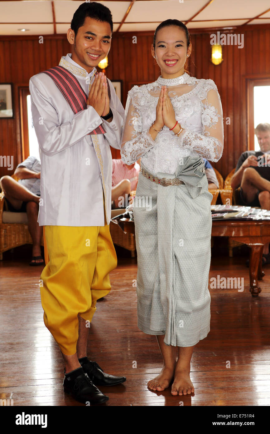 A male and female in traditional Cambodian wedding ...